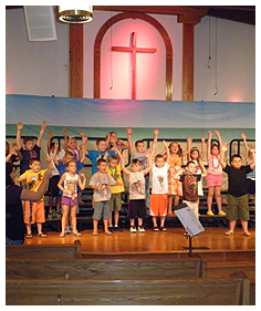 Children Singing and Dancing on Stage